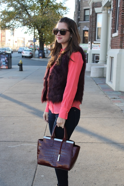 La Mariposa: Burgundy Fur Vest with contrasting coral blouse
